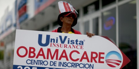 UniVista Insurance company actively working to sign up non-English speaking people for the Affordable Care Act, also known as Obamacare, on February 5, 2015 in Miami, Florida. The Miami-Fort Lauderdale-West Palm Beach metropolitan area signed up more than twice as many as the next large metropolitan area, Atlanta, Georgia.