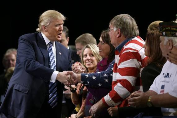 Donald Trump greeting veterans and their families at a campaign event.
